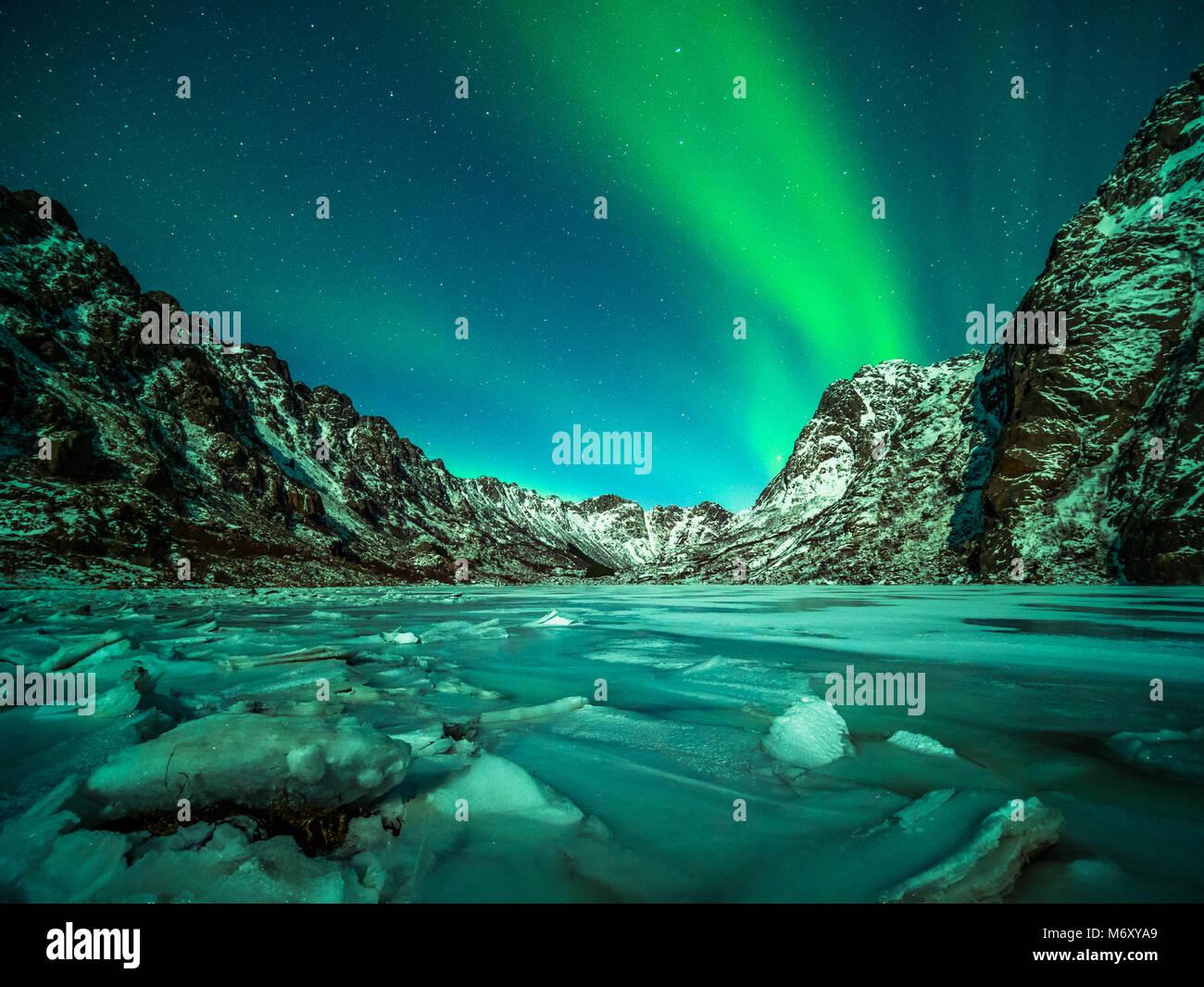 Northern light over the islands of Lofoten. - Stock Image