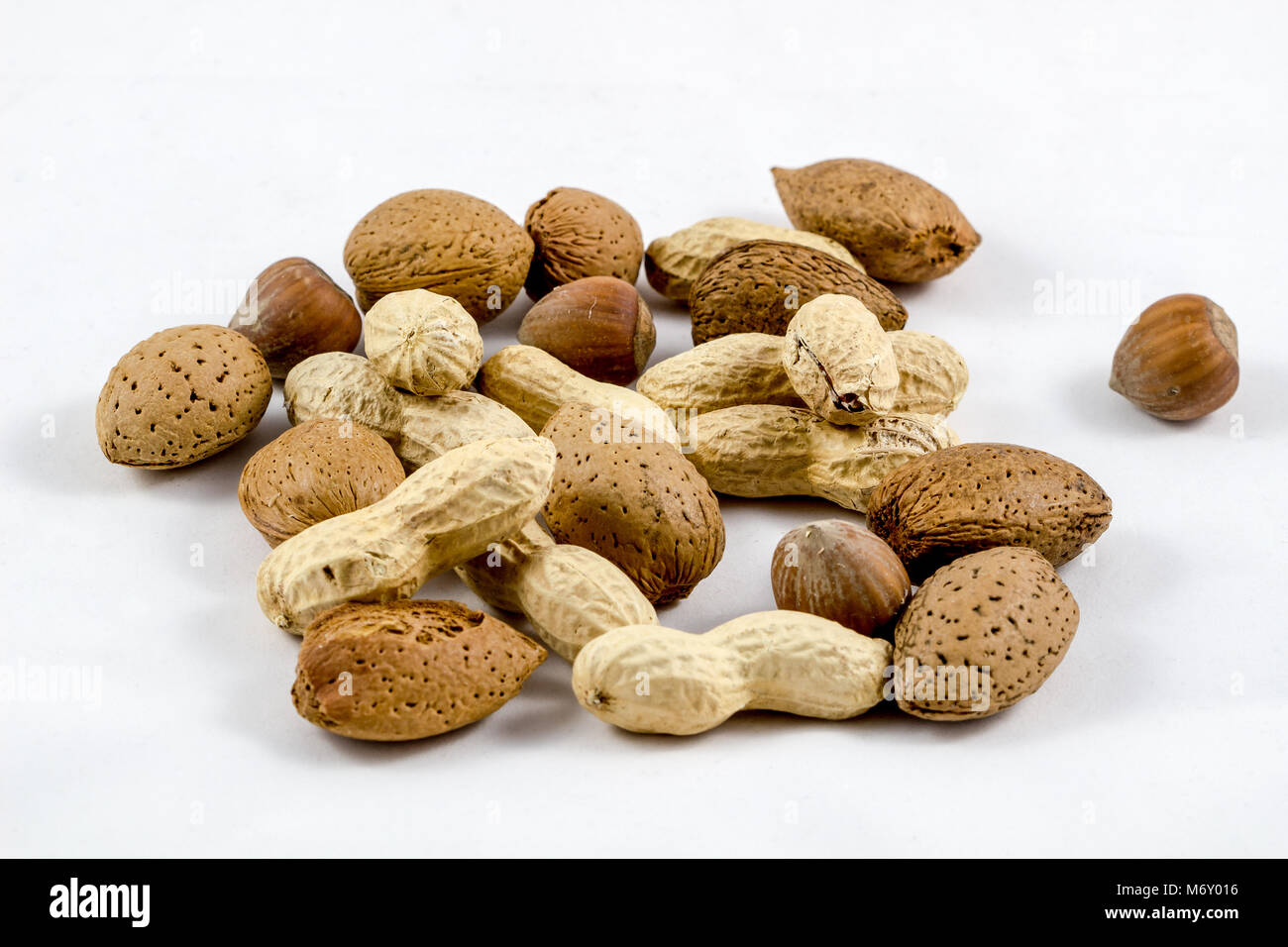 Healthy mix nuts on white background. Almonds, hazelnuts, peanuts Stock Photo