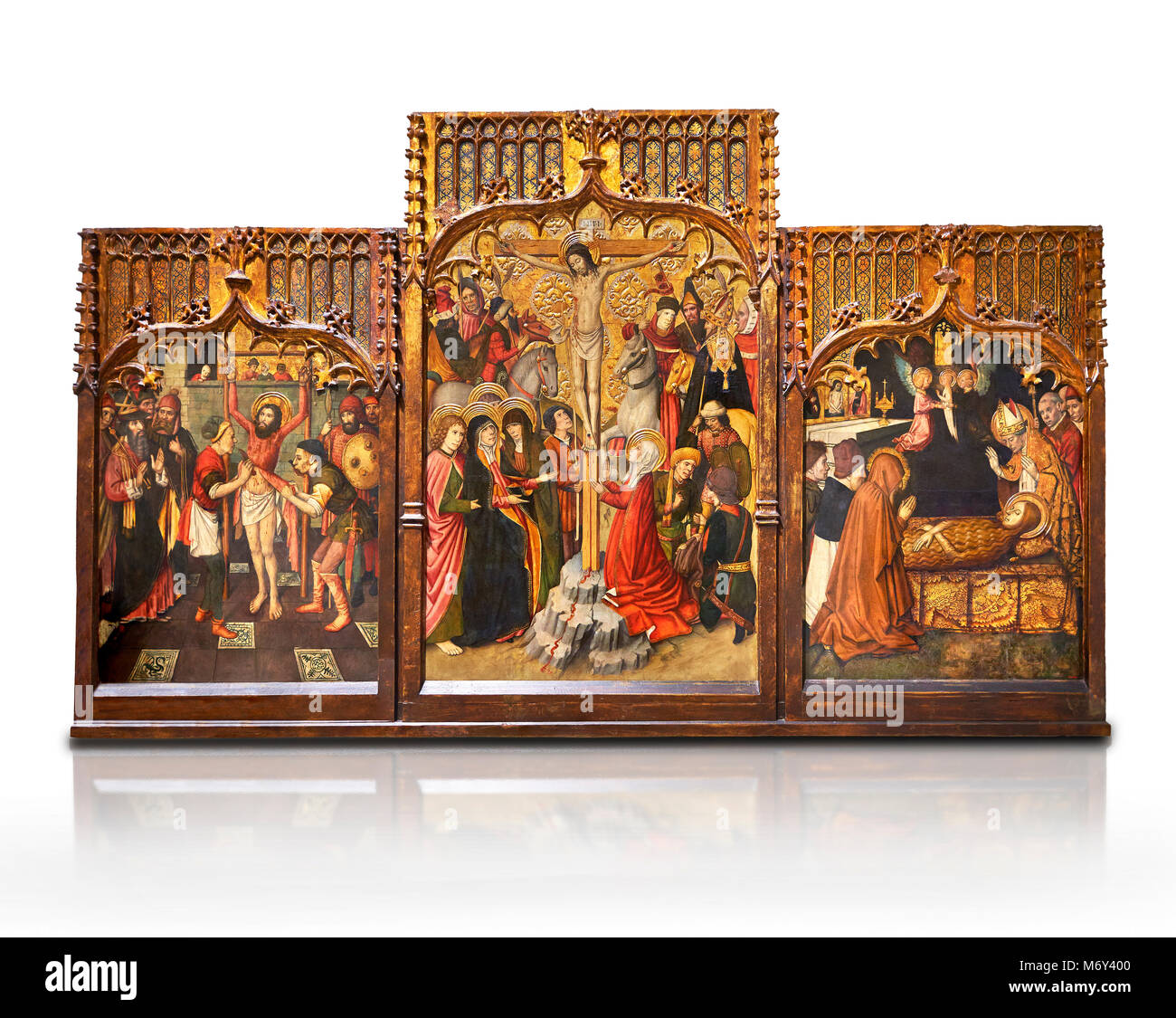 Gothic Catalan altarpiece of, left to right, the martydom of St Bartholomew, Calvaty and the deat of St Mary Magdelene, - Stock Image