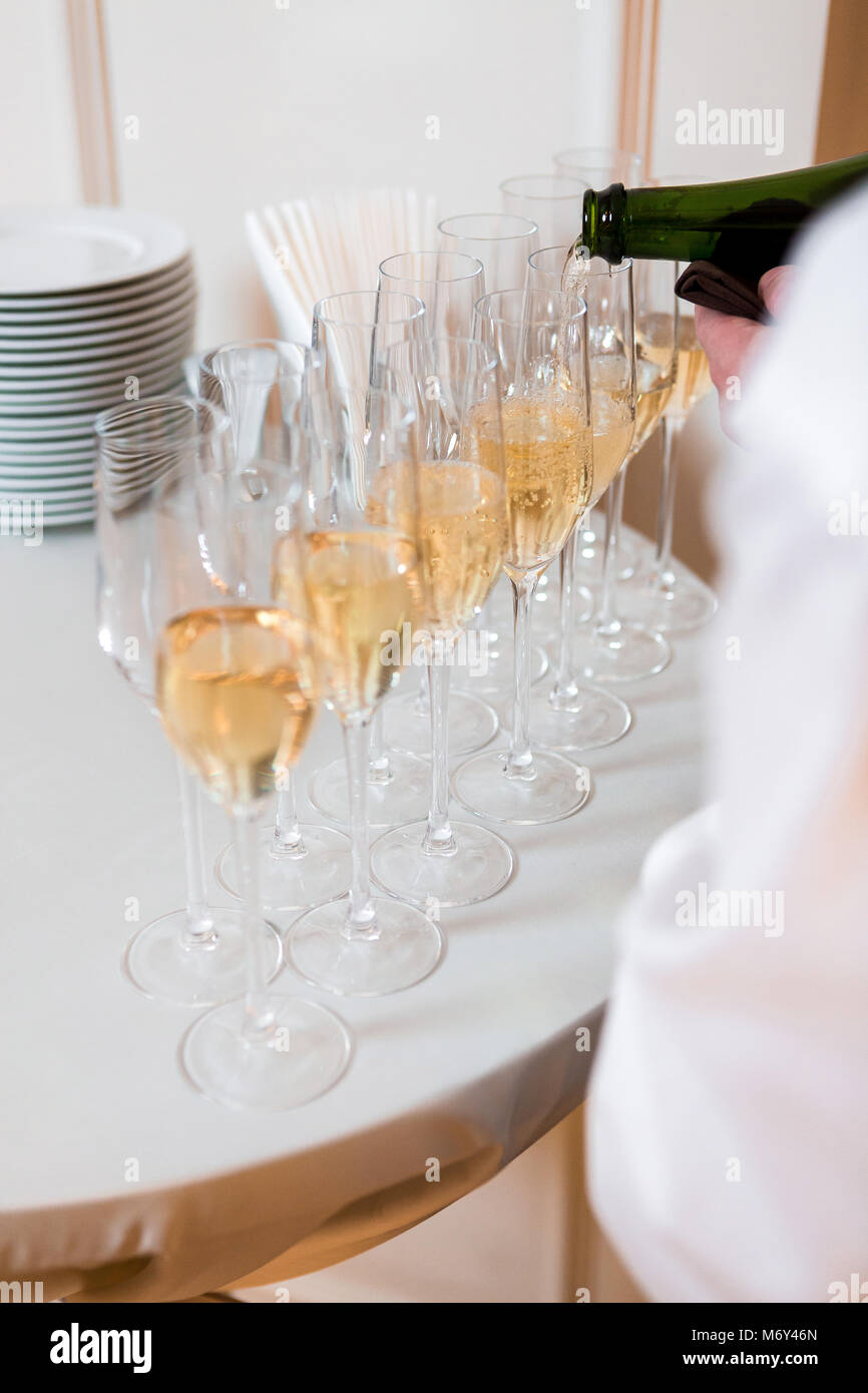 waiter pours champagne Stock Photo