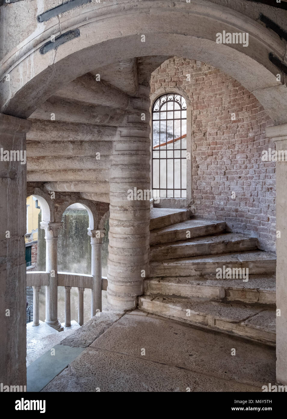 View of the stone spiral staircase structure at Palazzo