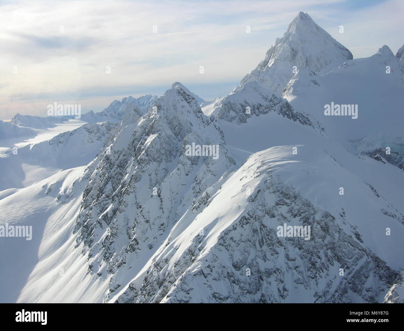 Chigmit Mountains   . The snow covered peaks of the Chigmit Range during winter - Stock Image
