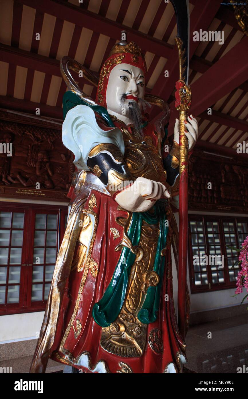 An intricately carved statue of a Chinese male warrior at the entrance to the Linh Ung Pagoda on Marble Mountain, - Stock Image