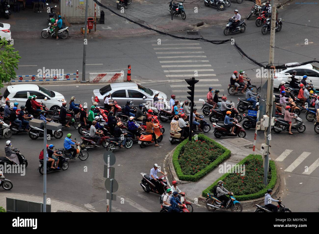 Crazy traffic at a crowded intersection in District 1 of Ho Chi Minh City, Vietnam - Stock Image