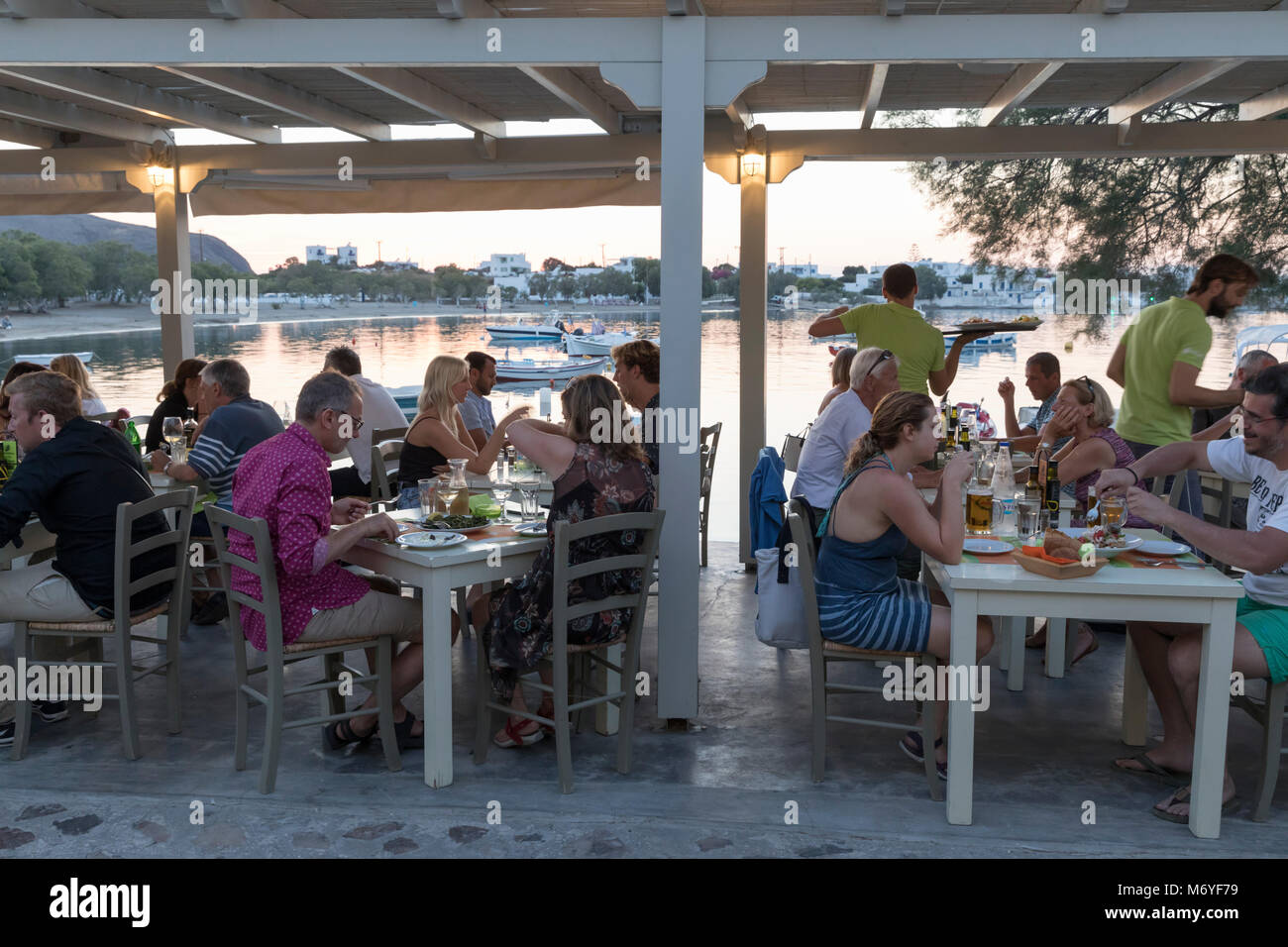 Harbour restaurant in evening, Pollonia, Milos, Cyclades, Aegean Sea, Greek Islands; Greece; Europe - Stock Image