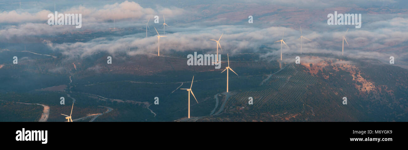 aerial morning view landscape of the Greek side of Cyprus; showing windmill farm on hills near Archimandrita Stock Photo