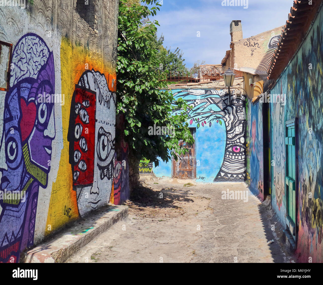 Europe, Greece, Attica Athens,Anafiotika Plaka  ,Graffiti On Wall At Street The part of old town of Athens called - Stock Image