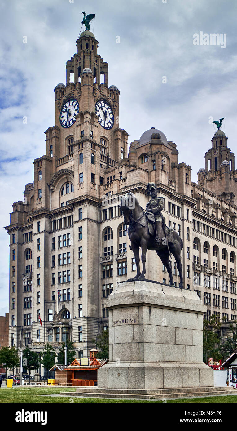 The Liverpool Insurance building reaches into the cloudy skies over the city. Before it, stands an equestrian statue - Stock Image