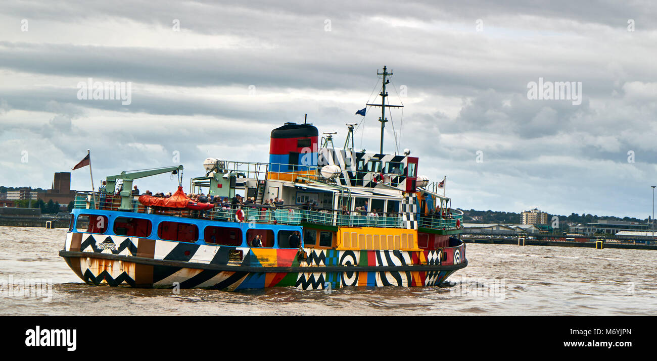 colored ferry boat , Liverpool from across the River Mersey, UK - Stock Image