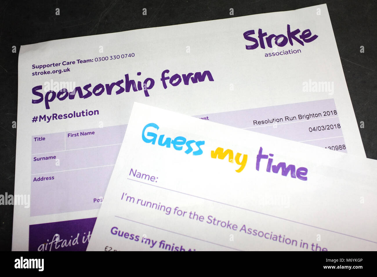 Documents from the Stroke Association Resolution Run charity event. - Stock Image