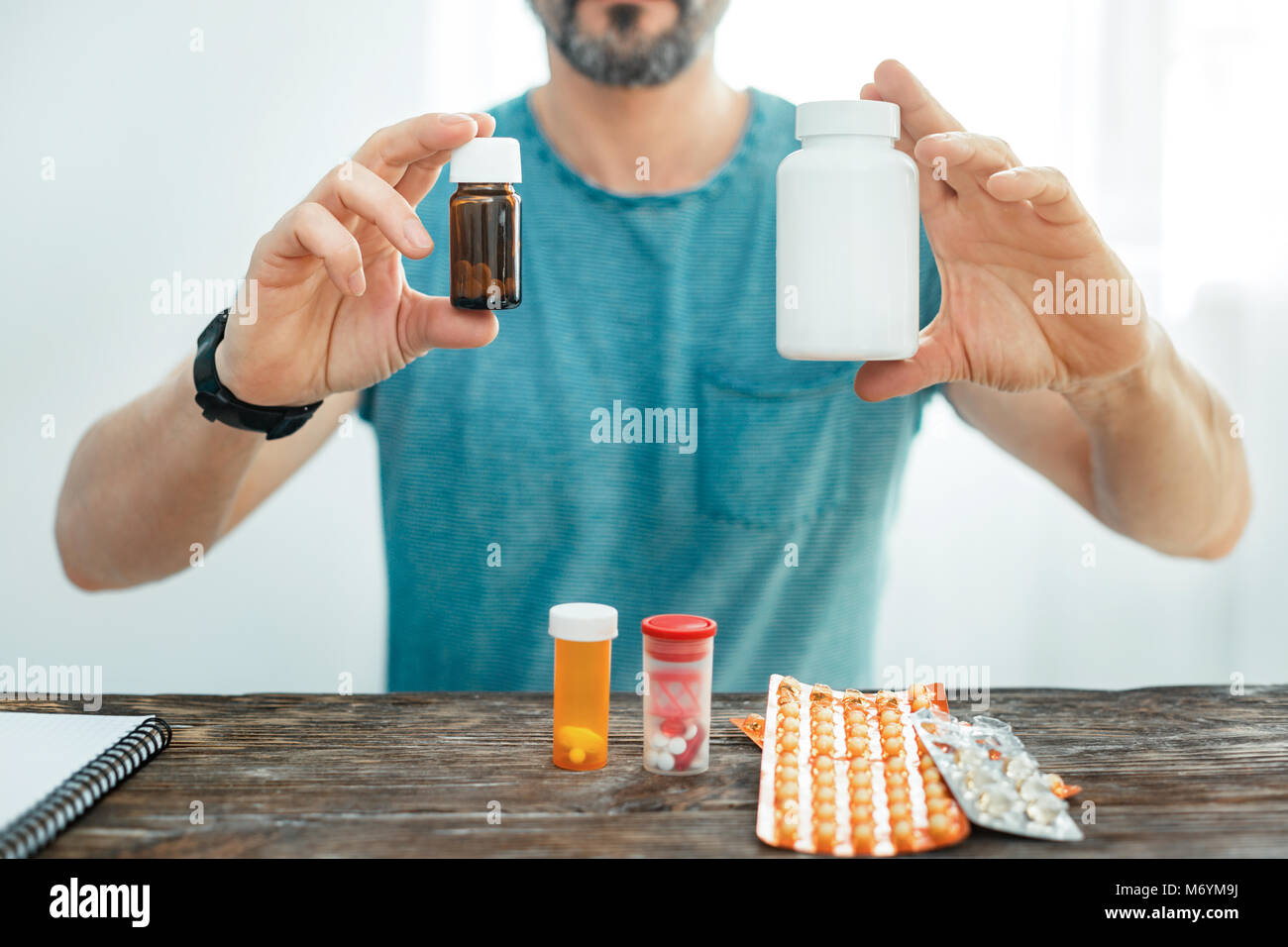 Expensive useful drugs remaining in hand. Stock Photo