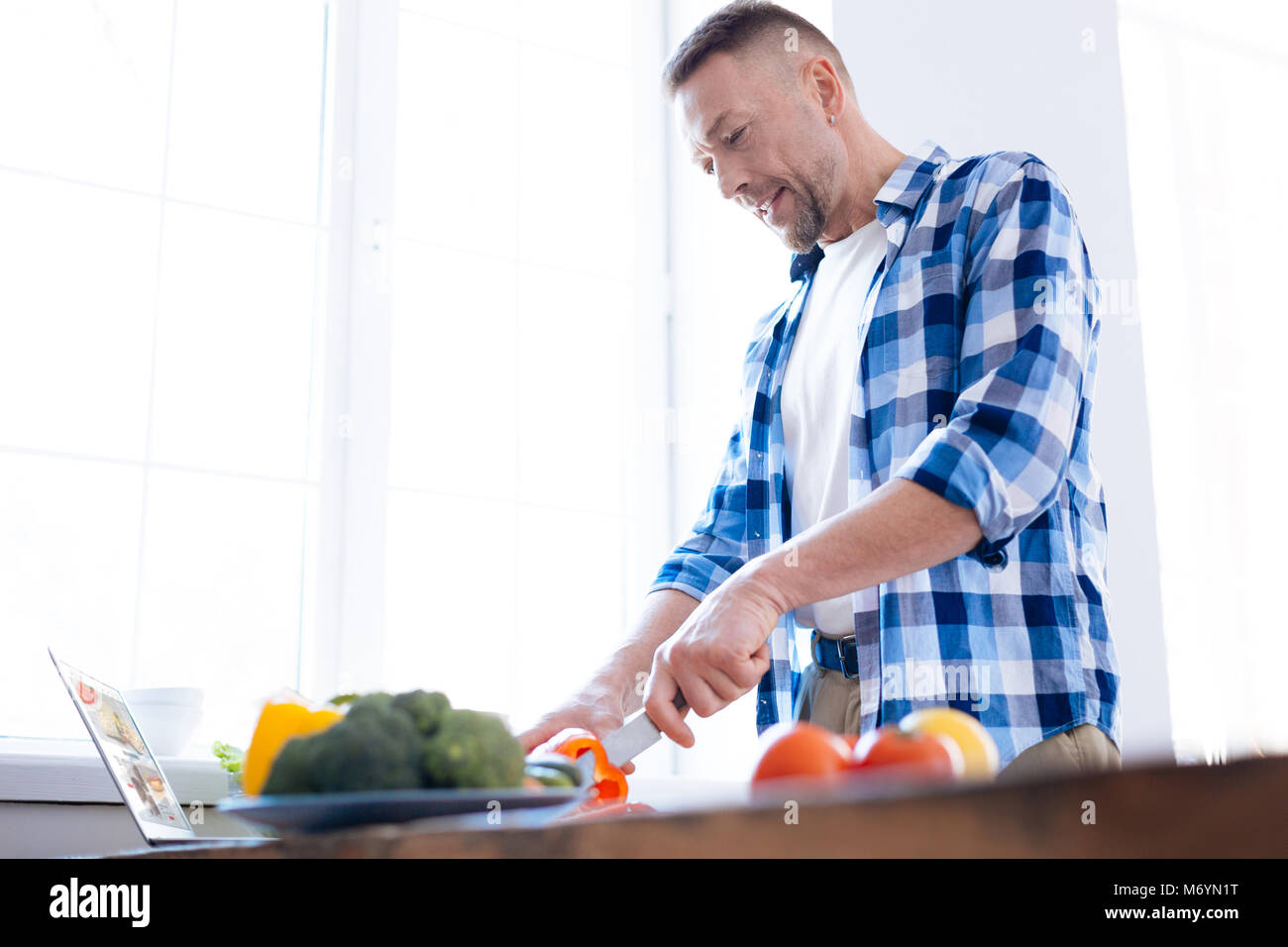 Concentrated handsome man studying biohacking - Stock Image