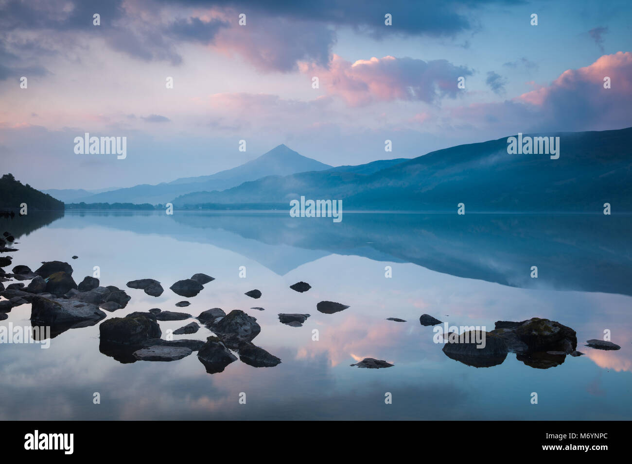 Schiehallion reflected in Loch Rannoch at dawn, Perthshire, Scotland, UK - Stock Image