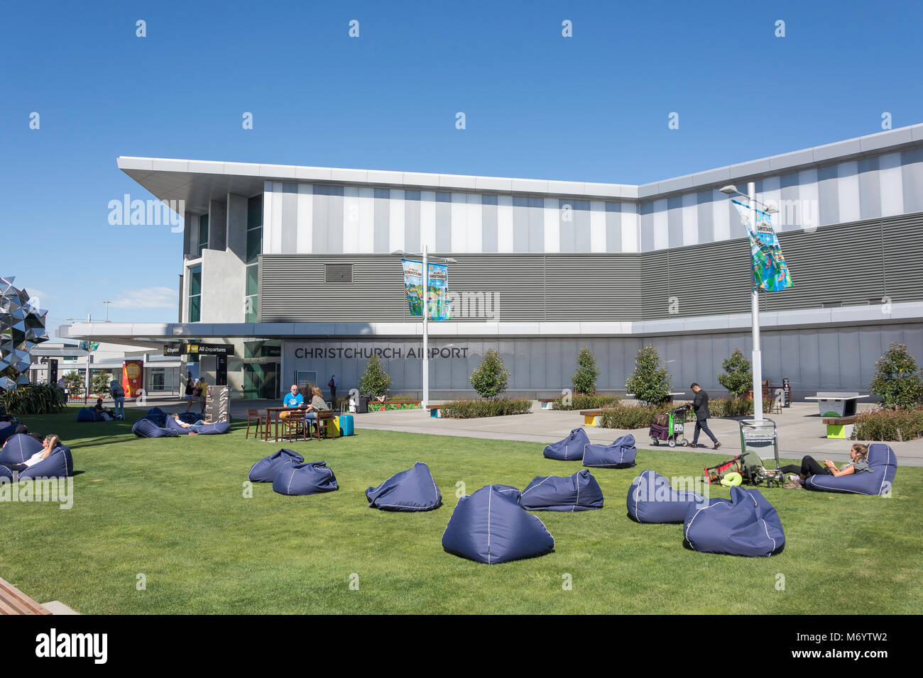 Lawn with bean bags and Departures Terminal at Christchurch Airport, Harewood, Christchurch, Canterbury, New Zealand - Stock Image