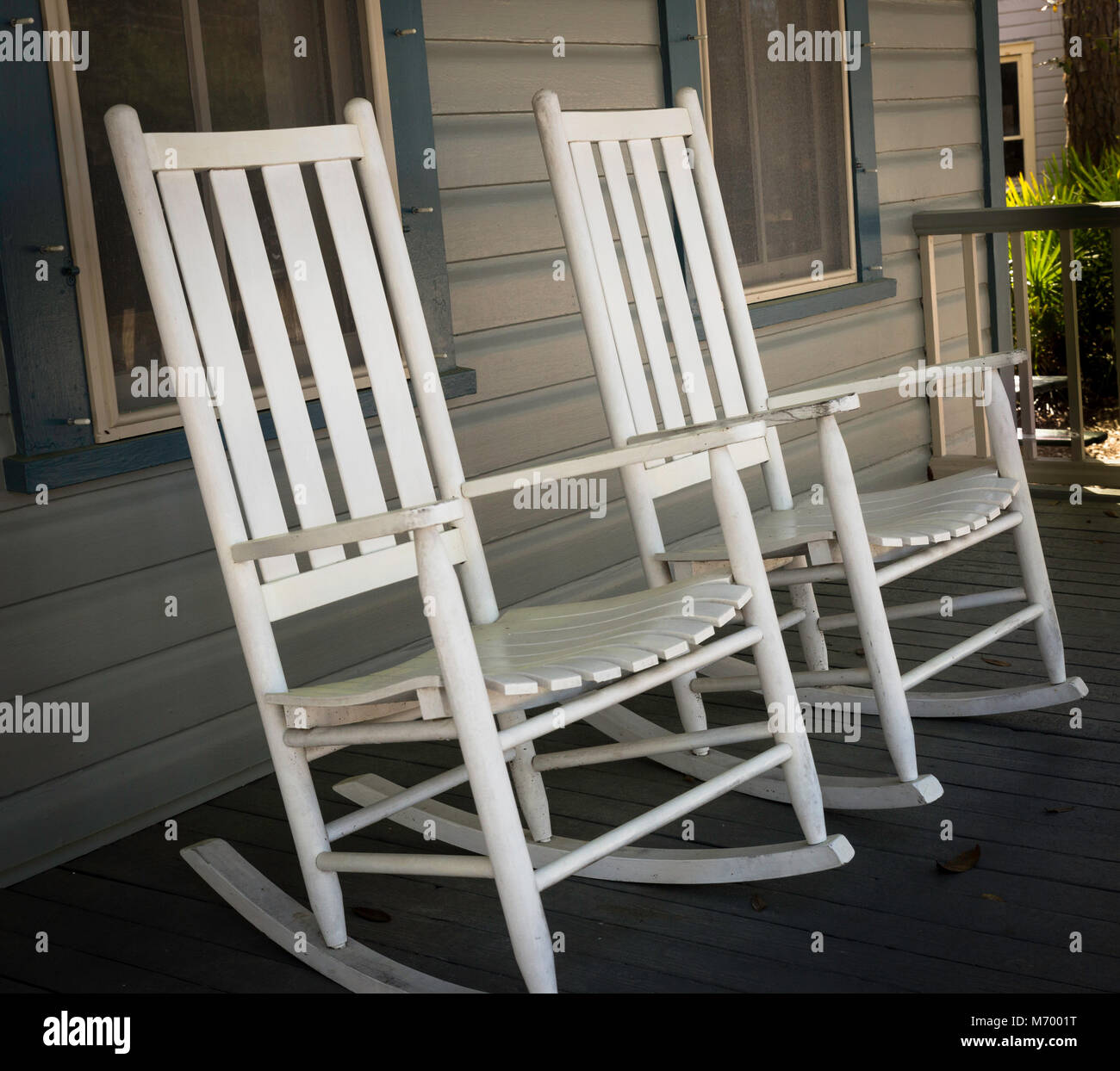Old Fashioned Wooden Rocking Chairs On An Outdoor Covered Veranda