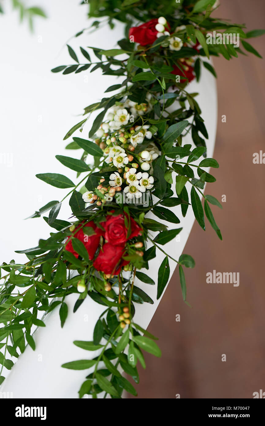 Decorative decoration of flowers.Greens, roses. Bath decor - Stock Image