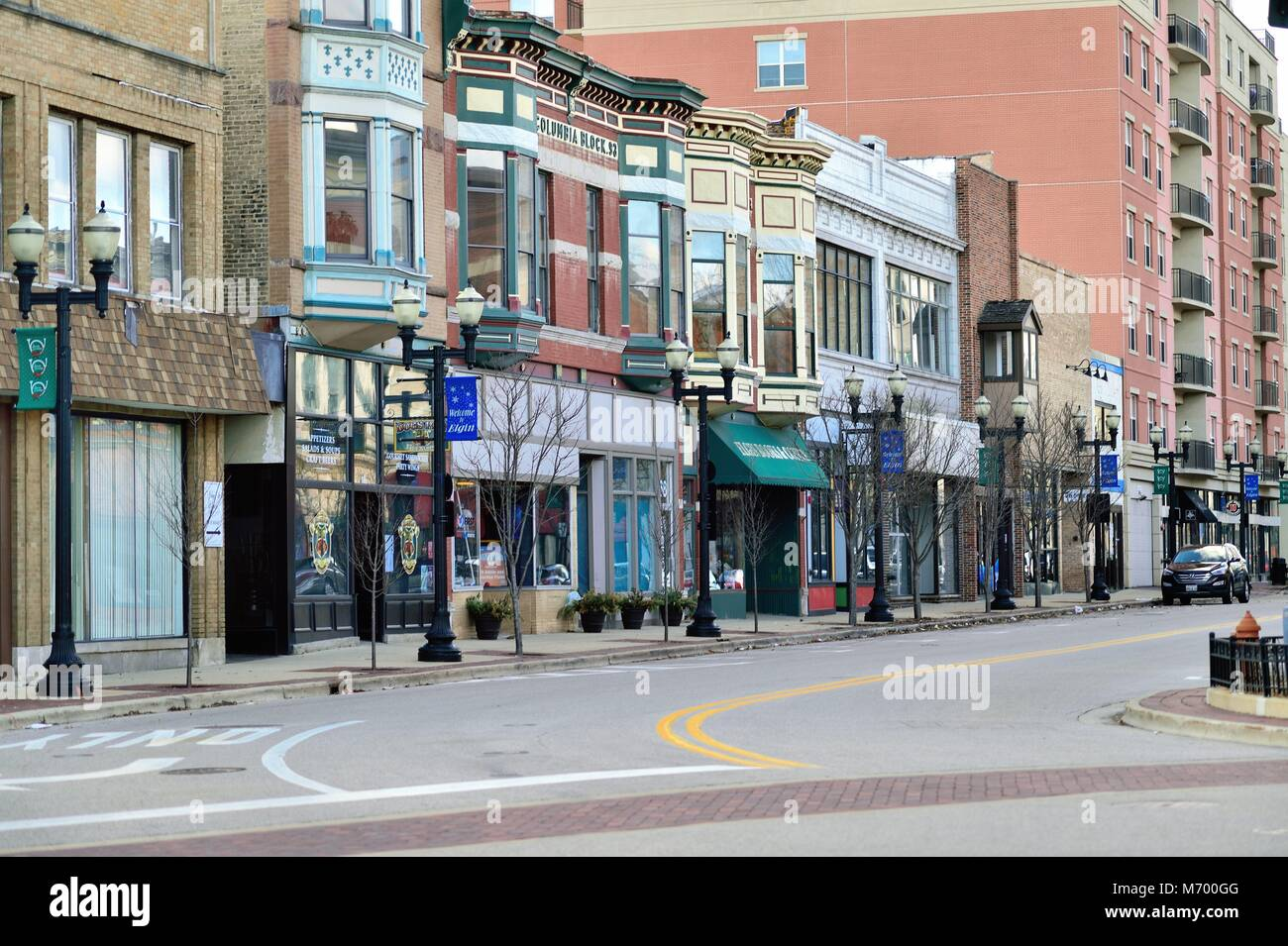 Elgin, Illinois, USA. Downtown street in the old river city of Elgin, Illinois. The architecture is sprinkled with - Stock Image