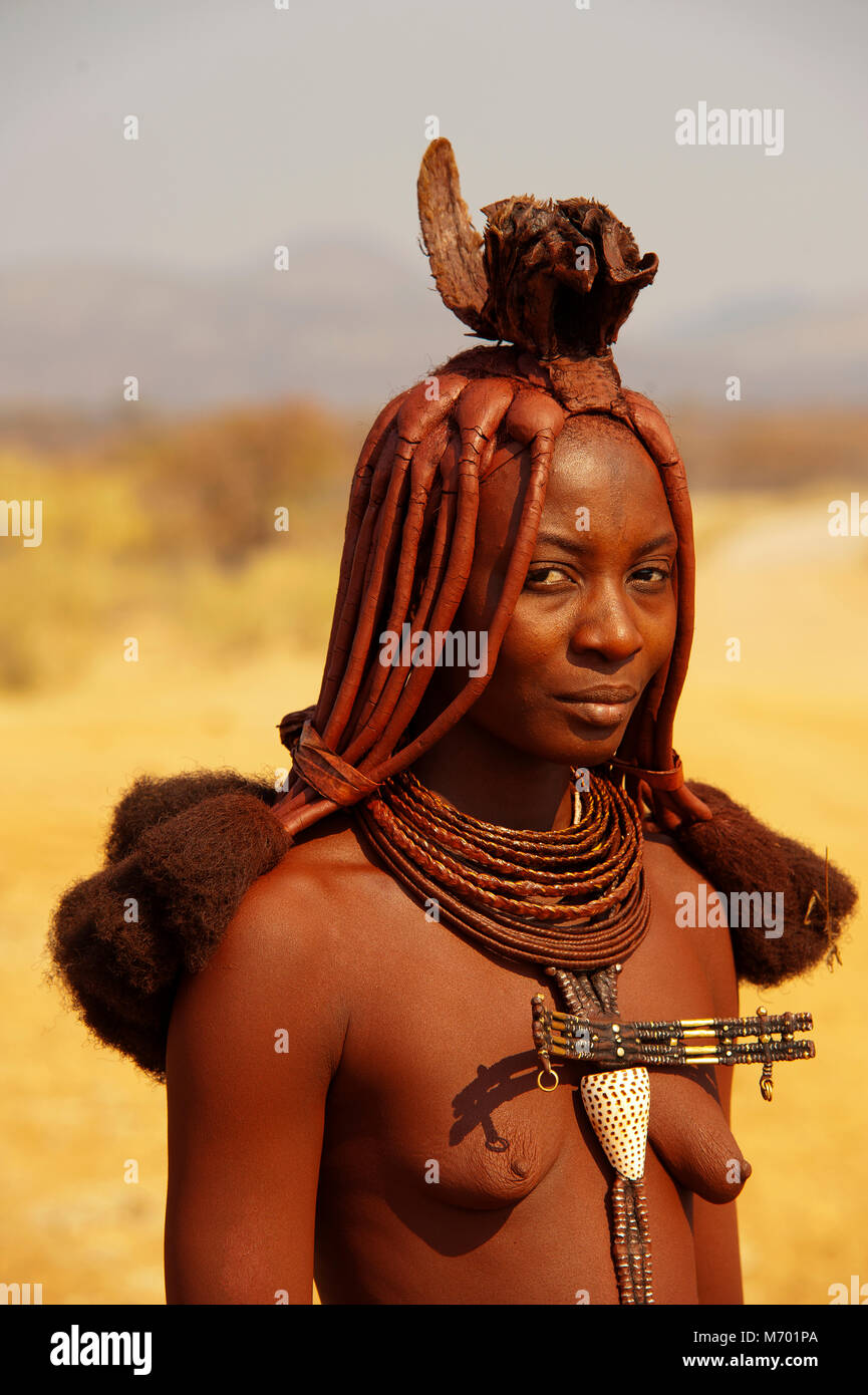 Himbas also lived also in south Angola, where they are called hereros. Near Epupa Falls there are many himba villages, - Stock Image