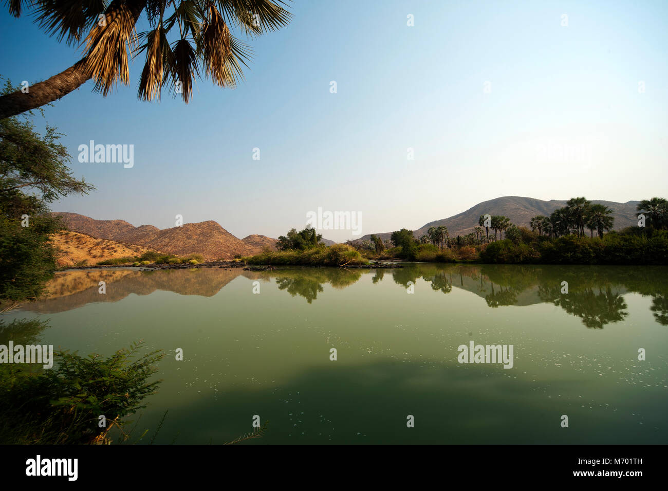 Placid waters of the Kunene river near Epupa Falls on the Angola border, Kunene region. On the other side of the - Stock Image