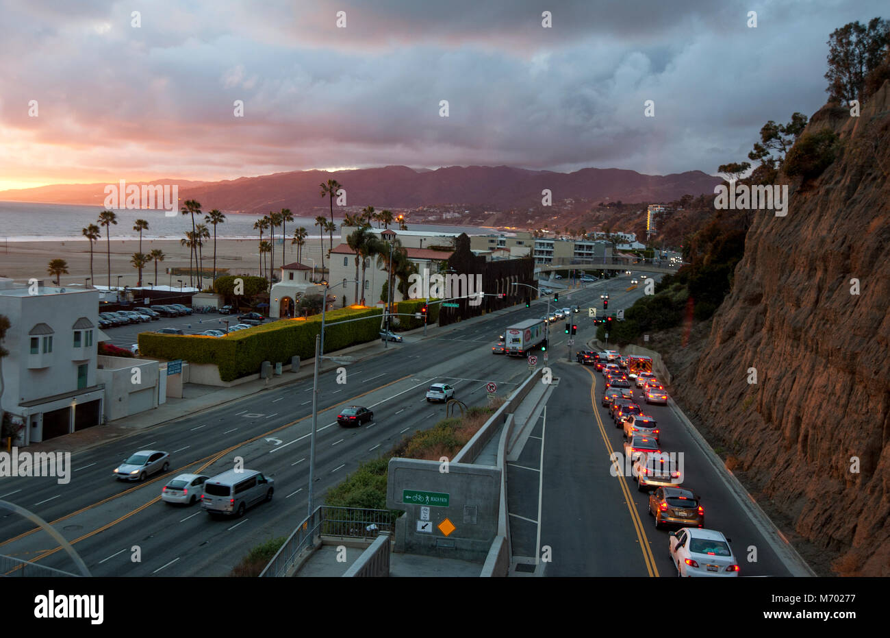 Cars on the California Incline heading down onto the Pacific Coast Highway in Santa Monica at Sunset. - Stock Image