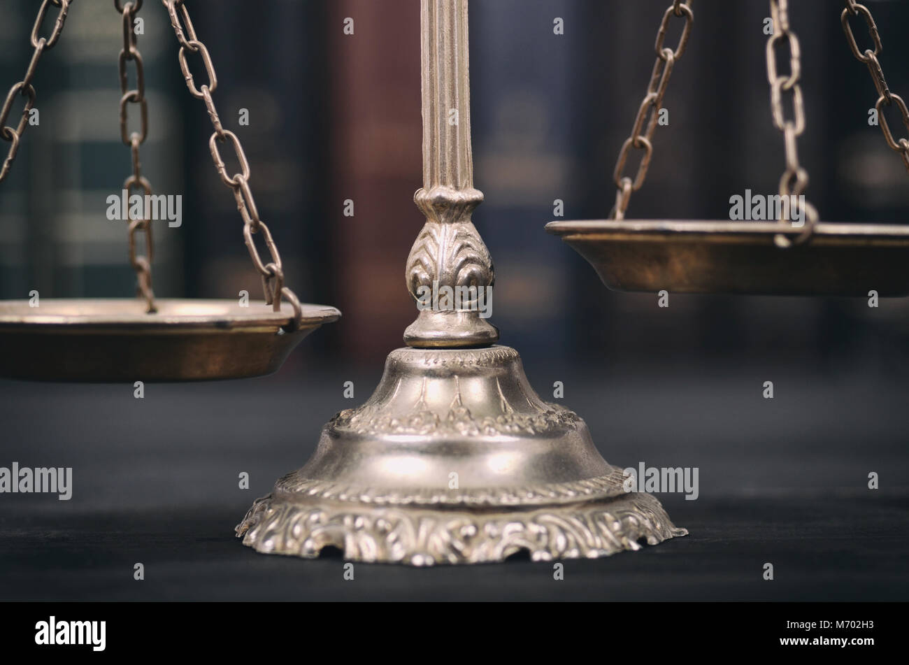 Law and Justice, Legality concept, Scales of Justice on a black wooden background. - Stock Image