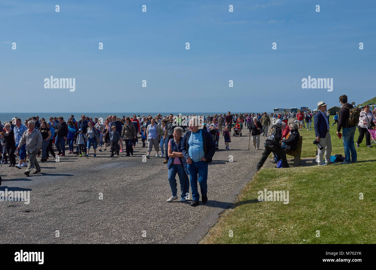 The Crowds follow the Marching bands and parade at a Public event honouring local heroes in Arbroath, Scotland. - Stock Image