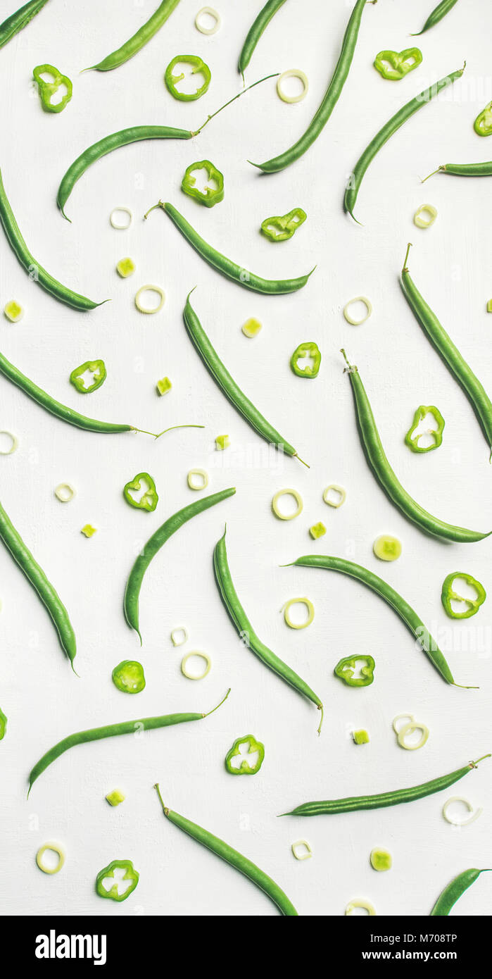 Flat-lay of fresh green beans over white background, top view - Stock Image