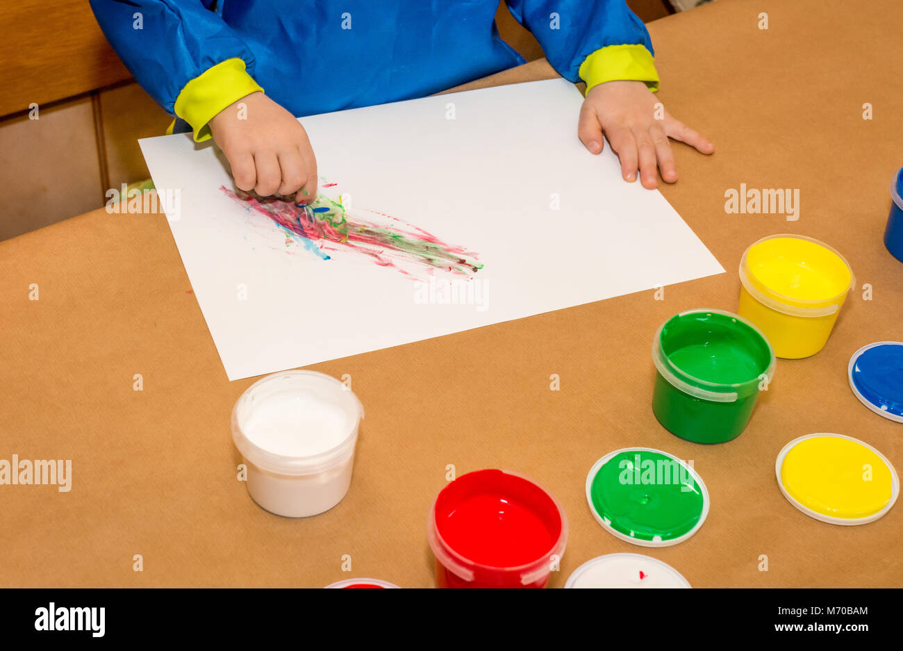 Child hands painted in colorful paits. Education, school, creativity and painting concept. Soft focus an blurry - Stock Image