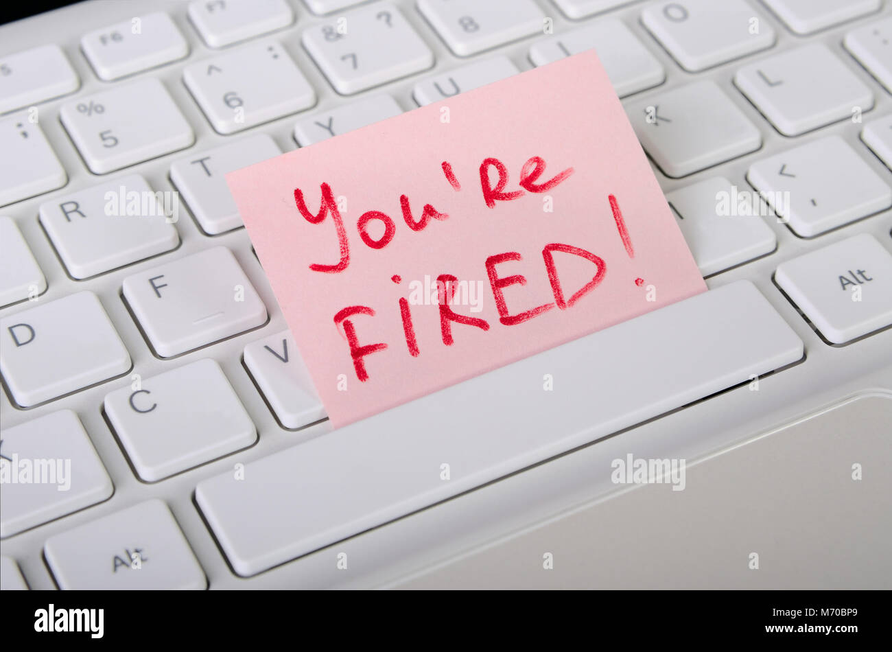 Job dismissal notice is on computer keyboard - Stock Image