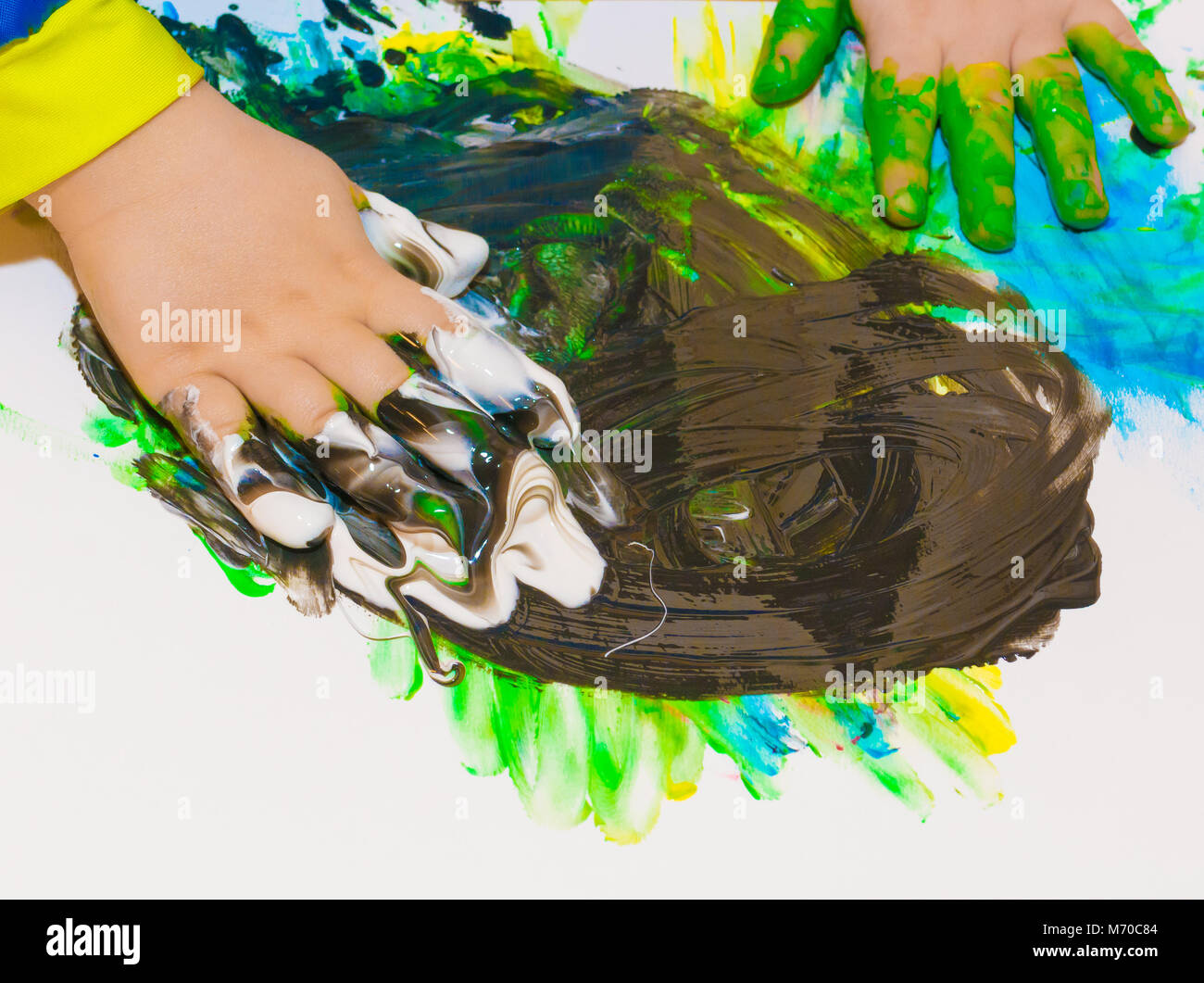 Child hands painted in colorful paints. Education, school, creativity and painting concept. Soft focus an blurry - Stock Image