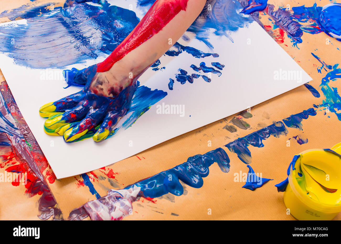 Child hand painted in colorful paints. Education, school, creativity and painting concept. Soft focus an blurry - Stock Image