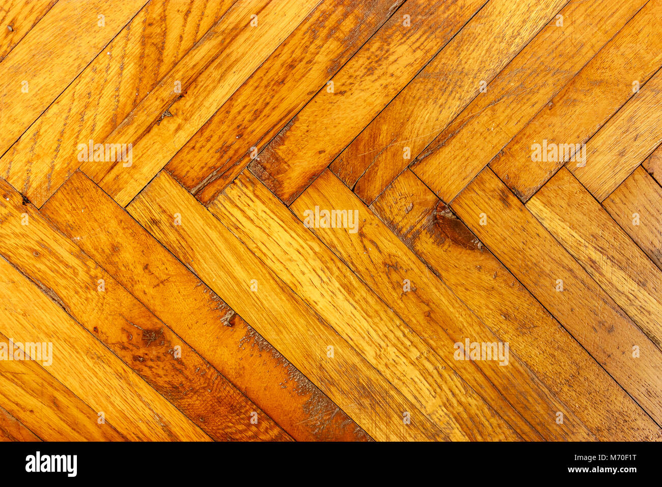 Old gold wooden background, horizontal orientation, close up - Stock Image
