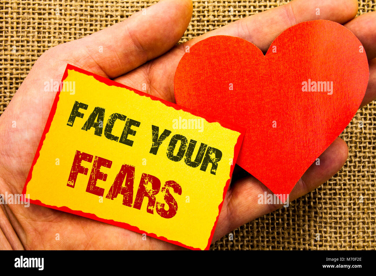 Handwriting text showing Face Your Fears. Business concept for Challenge Fear Fourage Confidence Brave Bravery written Stock Photo