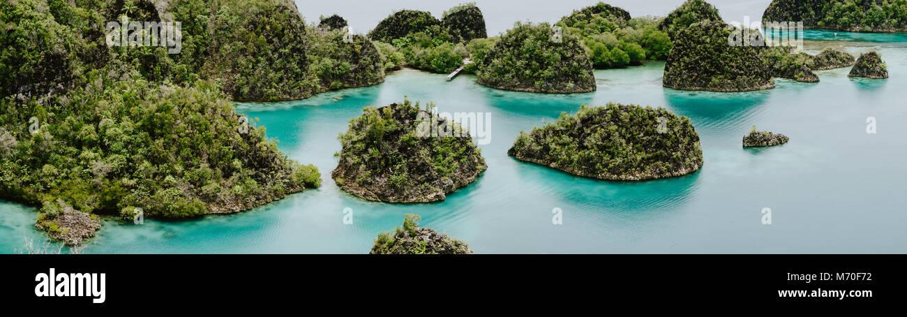 Painemo Islands panoramic shot, Blue Lagoon, Raja Ampat, West Papua, Indonesia - Stock Image