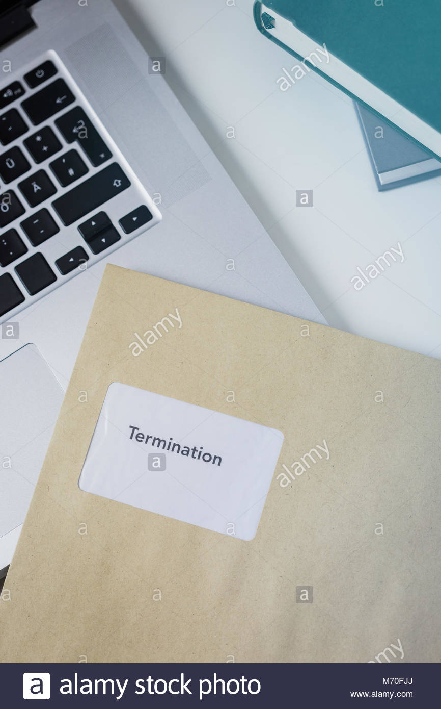 Termination or severance letter lying on a desk - Stock Image