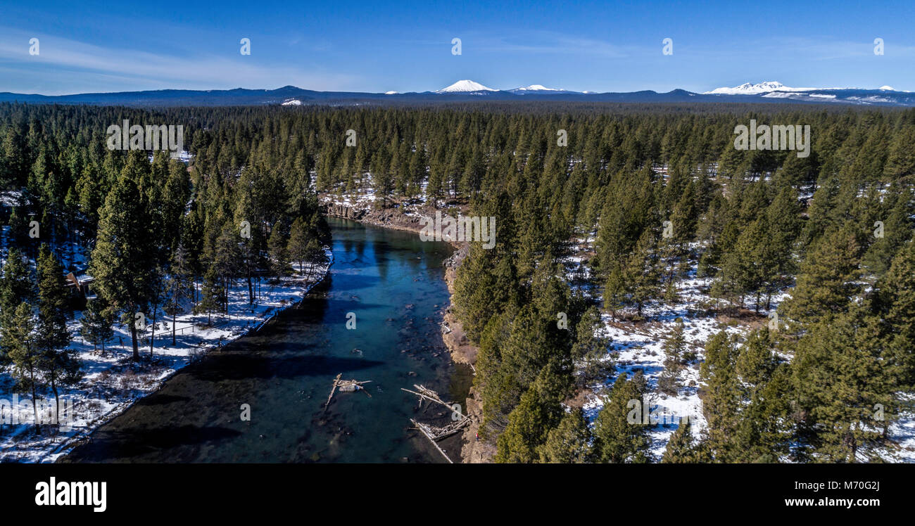 The Deschutes River and Snow Covered Cascades - Stock Image