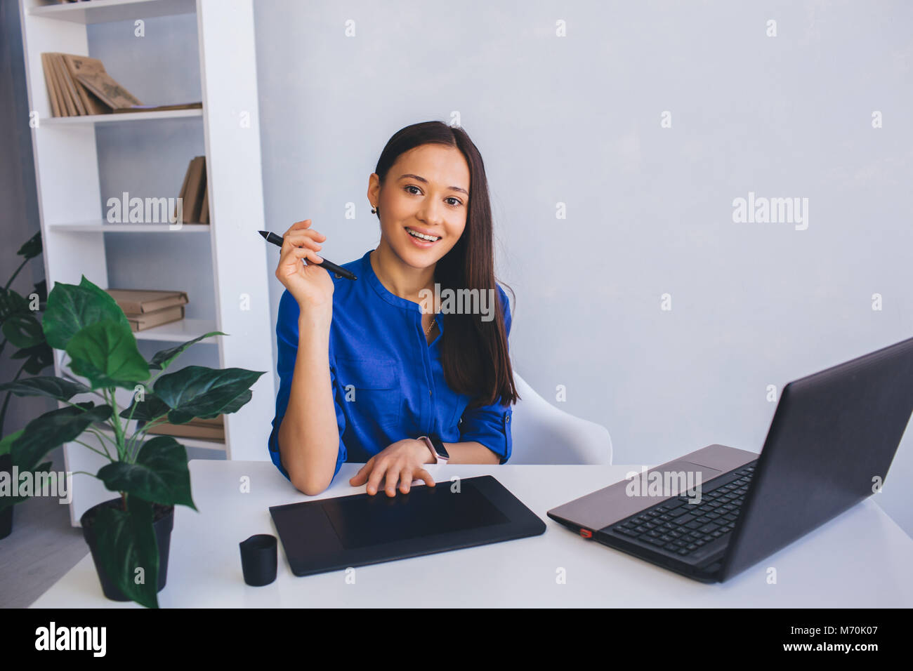 woman retoucher at her working place - Stock Image