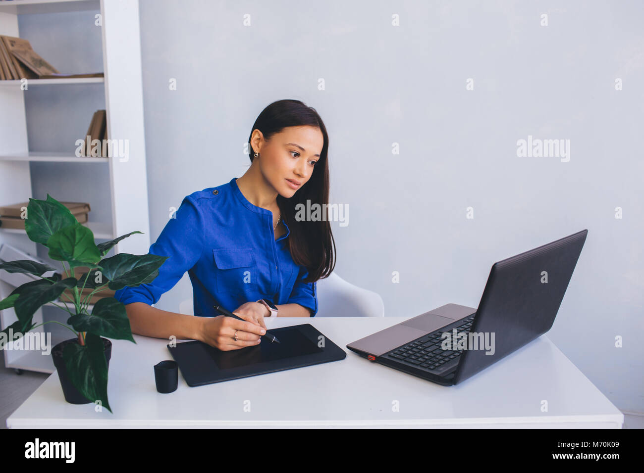 woman Graphic Designer at her working place - Stock Image