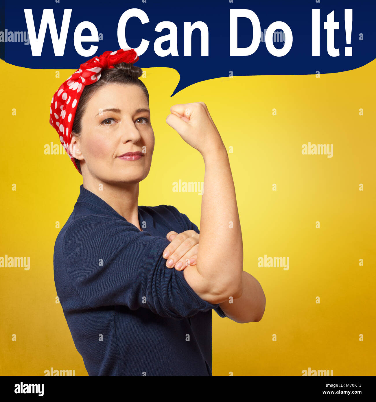 Tough and self-confident woman with a clenched fist, speech bubble with text WE CAN DO IT, tribute to american icon - Stock Image