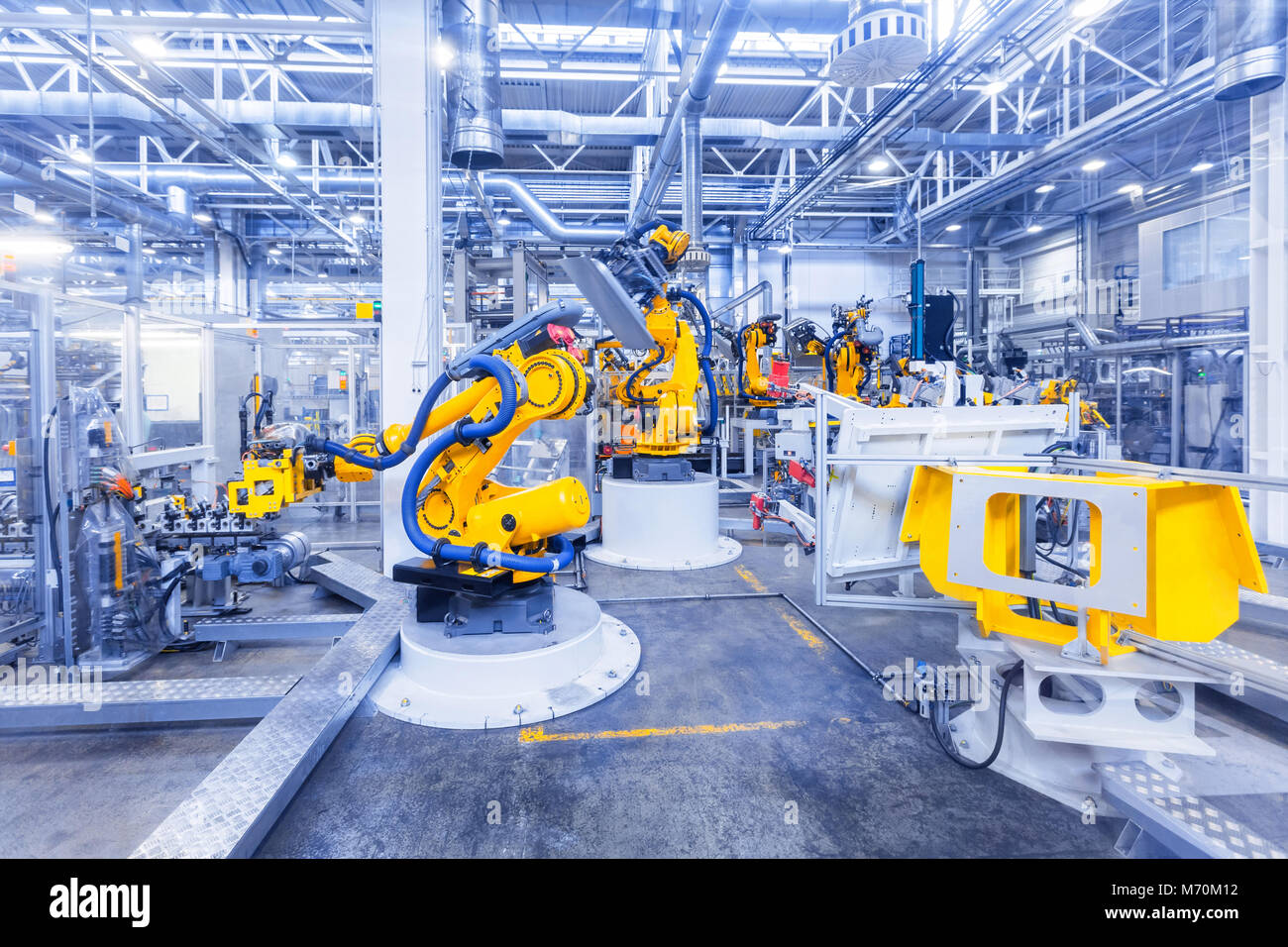 robots in a car plant Stock Photo