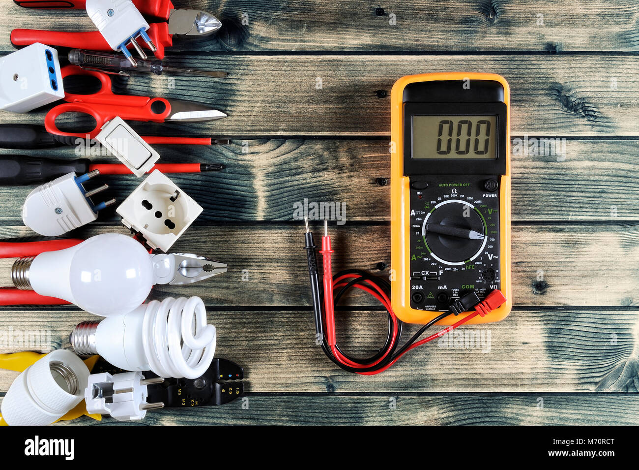 Close-up of work tools and electrical equipment on an antique wooden table with space for text / announcement Stock Photo