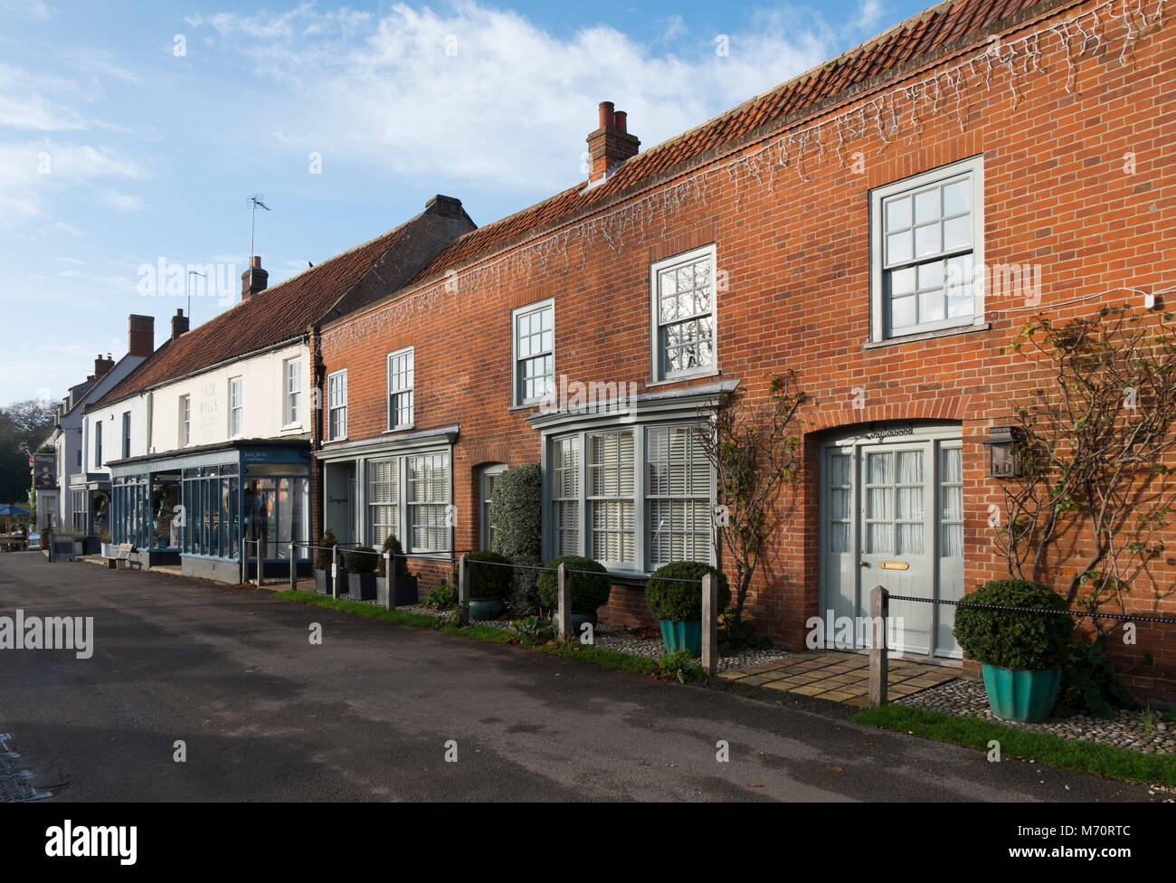 Jack Wills, contemporary clothing shop next door to a residential house in Burnham Market, North Norfolk, UK - Stock Image