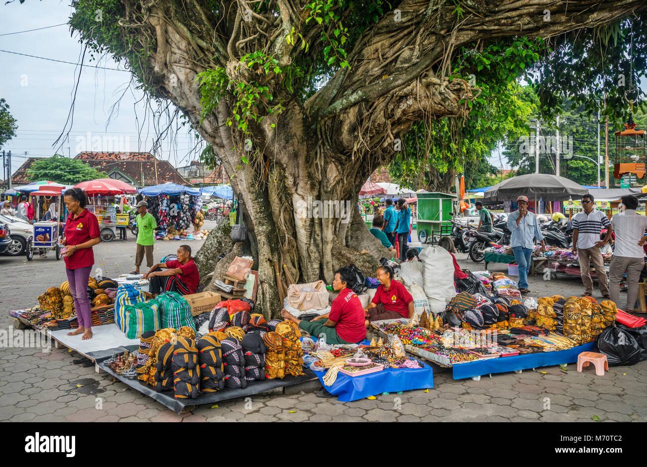 souvenir merchants under a Banyon tree at the Kraton Yogyakarta, Central Java, Indonesia - Stock Image
