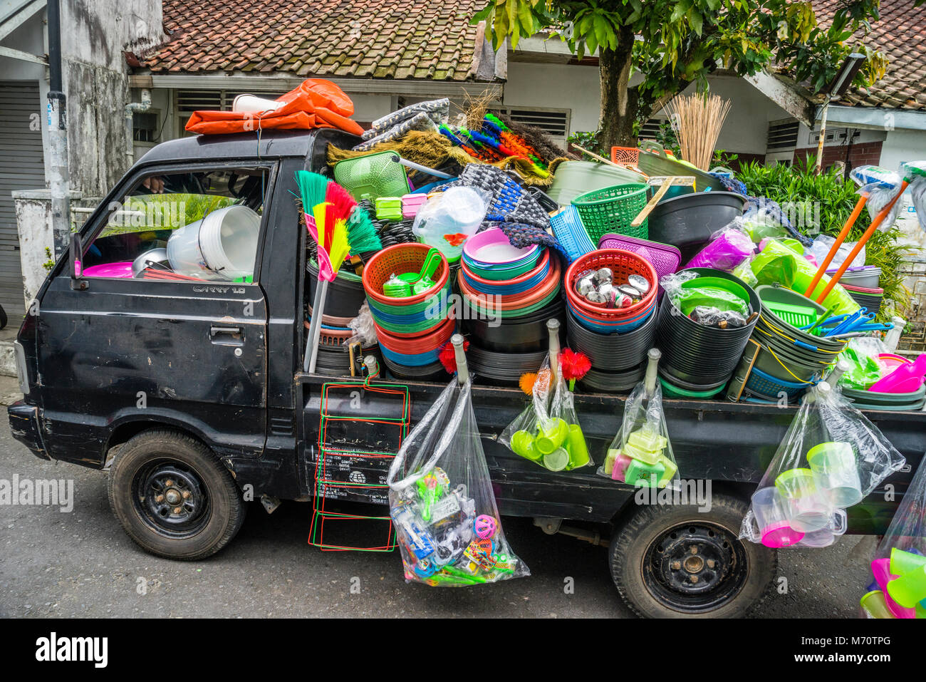 plastic ware merchant in the Kraton neighbourhood of Yogyakarta, Central Java, Indonesia - Stock Image
