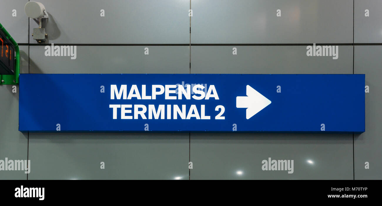 Sign pointing towards Malpensa Terminal 2, which services national as well as EasyJet flights throughout Europe. - Stock Image