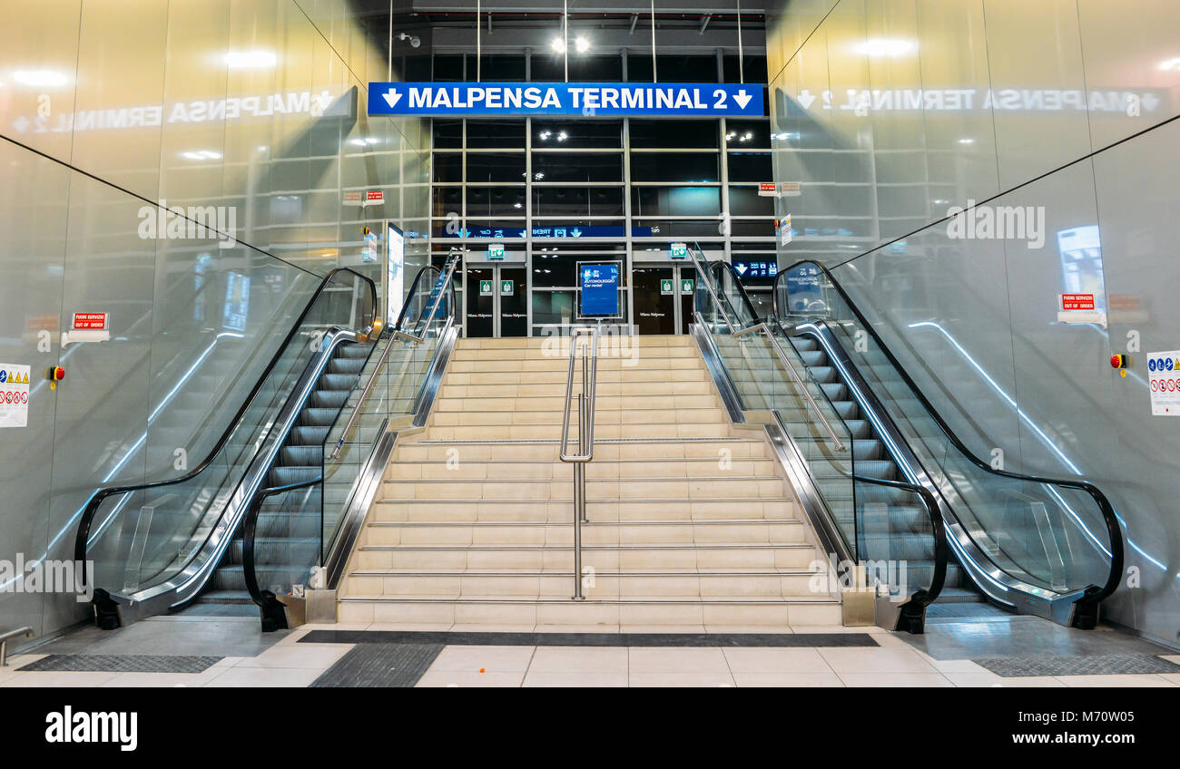 Sign pointing towards Malpensa Terminal 2, which services national as well as EasyJet flights throughout Europe - Stock Image