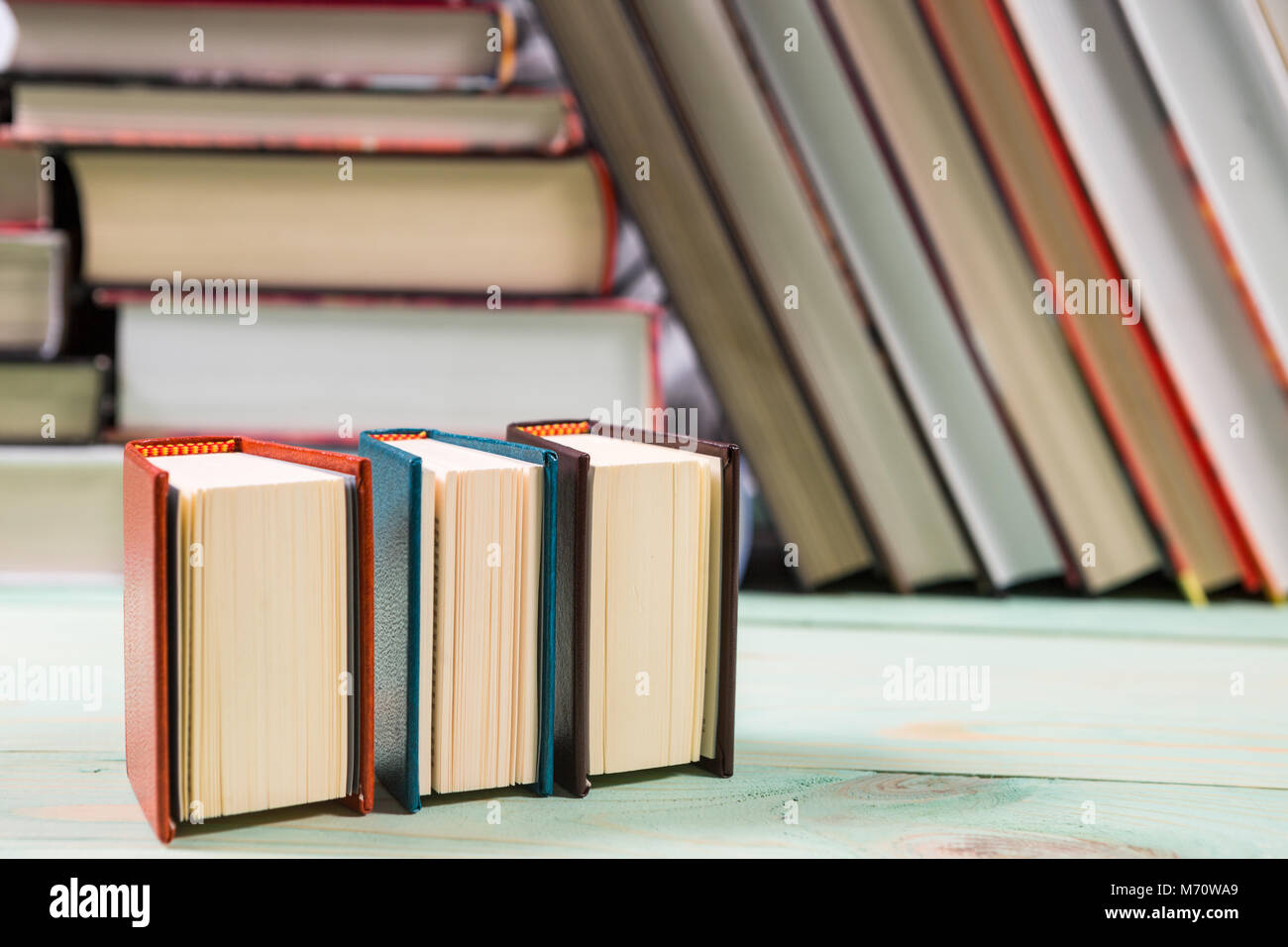 Pile of books on wooden background - Stock Image