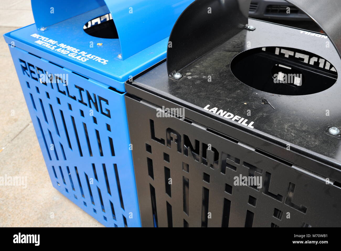 Recycling bin container next to trash bin labeled 'Landfill' in USA. - Stock Image
