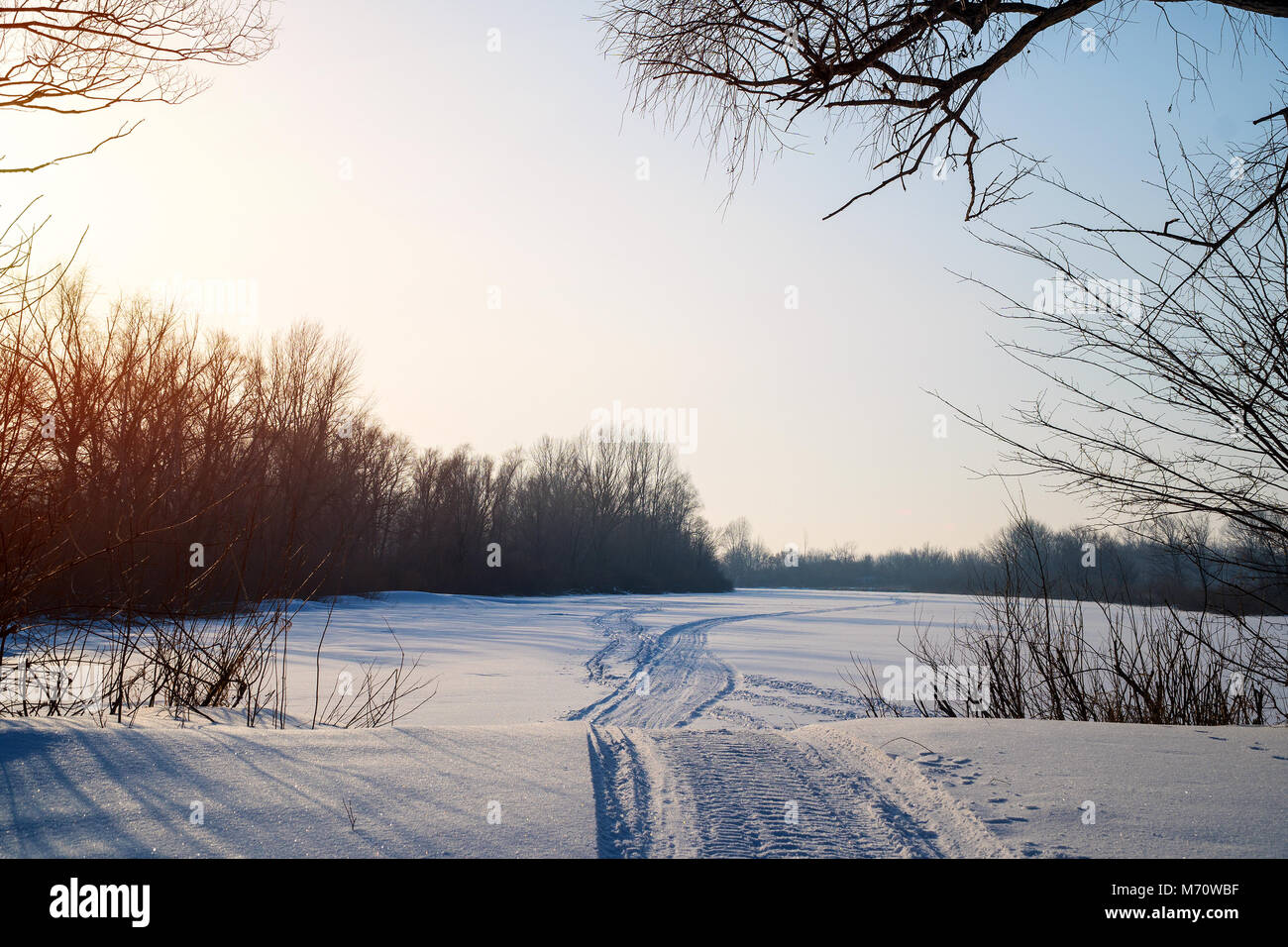 Snowmobile trail in the snow - Stock Image