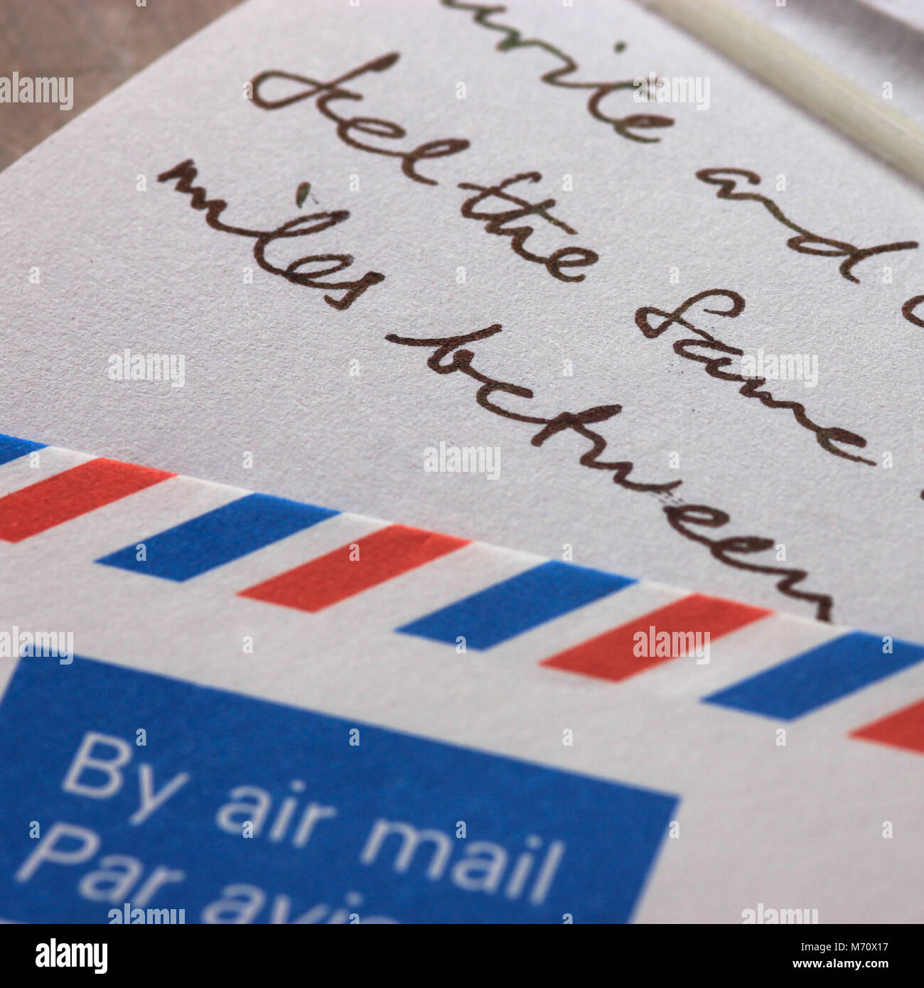 Air Mail envelope with part of hand written letter writing abroad to pen pal family loved ones - Stock Image